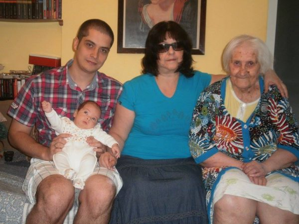 Our family's savior, my grandmother, my mother, myself and baby Romanian. Four generations on one couch.