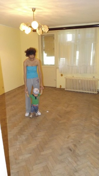The living room, large by Romanian standards. The original flooring is in decent condition. Yup, that's Baby Romanian who's starting to learn how to walk.