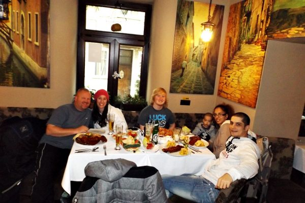 The American and the Romanian family enjoying dinner in Brasov